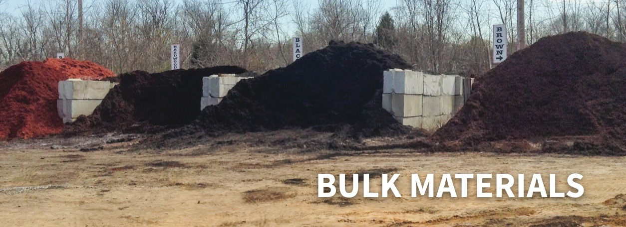 Piles of dirt and mulch bulk materials